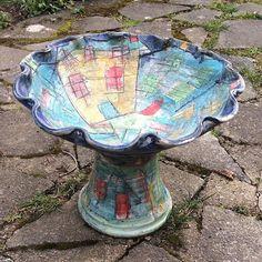 A pedestal bird bath with my sea house design.  by yarnbowl987