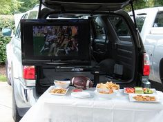 Tailgate TV Stand - Watch your TV anywhere off the back of your vehicle while tailgating. Tailgate Tent, Tailgating Gear, Tailgate Games, Tv Bracket, Mounting Brackets, Camping Table, Tent Poles, Cord Organization, Mounted Tv