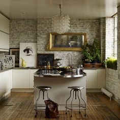 Dream Kitchen. The combo of glam, and functionality. Sleek cabinets, artwork, and exposed brick, do the job for me.