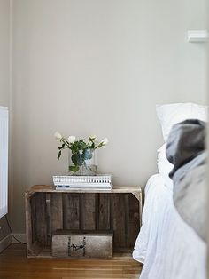 vintage crate turned into bedside table. nice idea!