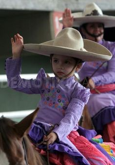 Escaramuza charra (mexican cowgirl) - The girls start riding and training with ponies at a very young age. This little girl is about 4 - 5 yrs. old. By the time this child is a teenager, she will be an expert equestrian in this genre. This is a very important tradition in this region and it is taken very seriously.