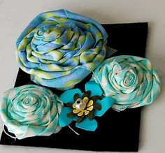 Cute flowers that can be put on headbands or clips.
