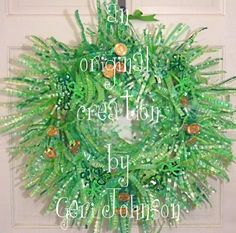My recycled water bottle/7 up bottle St Patrick's Day wreath.  Shamrocks made from pipe-cleaners and gold coins made from spray painted/glittered poker chips on pipe-cleaner stems