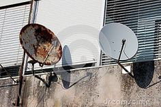 Photo about Rusted and new satellite dishes one next to another mounted on a wall under window blinds. Image of cracked, dishes, rusted - 99979408 Window Blinds, Blinds For Windows, Satellite Dish, Rust, African, Stock Photos, Dishes, City, Outdoor Decor