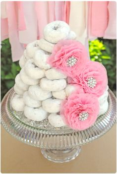 What a cute donut cake for a girl birthday! See more party ideas at CatchMyParty.com.