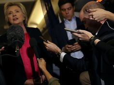 Democratic presidential nominee former Secretary of State Hillary Clinton speaks to members of the media aboard her campaign plane while traveling to Tampa, Florida on September 6, 2016 in White Plains, New York. Hillary Clinton is campaigning in Florida.