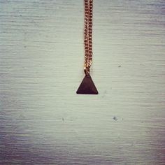 Tiny gold triangle necklace with a gold plated chain.  Its part of the new Little Darling* tiny little necklaces collection.  It measures 22cm