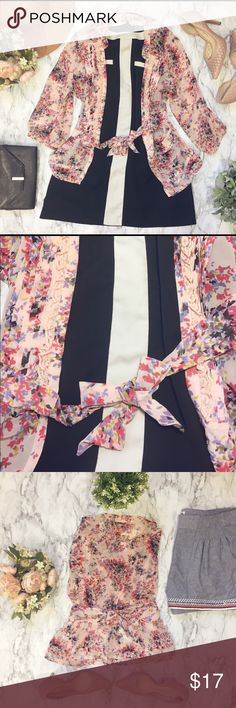 Floral Sheer Blouse w/ Beautiful Details %100 polyester 3/4 sleeve with floral pattern. Flowy and soft with ties on the front. Elle Tops Blouses
