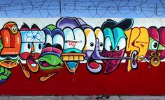 Detail characters of the long wall painted by Rime in Miami