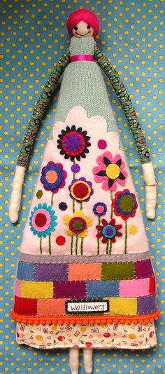 could this be an inspirations for wall hanging for little girls room (pockets for trinkets etc)