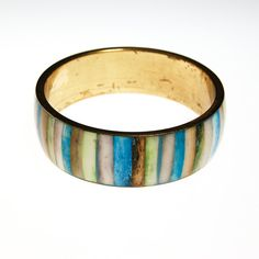 Dyed Inlay Striped Bracelet Made in India  Dyed Wood Inlayed in Brass Great Natural Colors in sky blue, light green, cream, brown Great Bohemian Chic Bracelet Perfect to layer and stack  DETAILS  1970s Era Made in India Gold tone bracelet Blue and earth tone stripes Excellent vintage condition  MEASUREMENTS Size 8 Bracelet 1 thick  Thank you for shopping Vintage Meet Modern  To see more of our collection, please click here: http://etsy.me/1Qg3NnL
