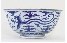 LARGE MING BLUE AND WHITE 'PHOENIX' BOWL UNDERGLAZE-BLUE JIAJING SIX-CHARACTER MARK AND OF THE PERIOD (1522-1566) Painted on the exterior in even washes of cobalt blue with a pair of sinuous phoenix in mutual pursuit amidst stylised scrolling clouds between two parallel lines at the base and below the rim, the interior with a small central roundel enclosing two similar birds, rim chip restored, small rim chips and cracks 15¾in. (40cm.) diam.