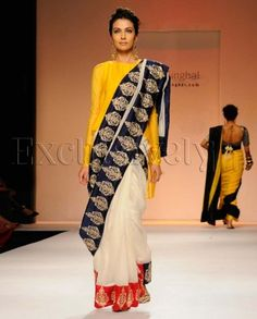 #Exclusivelyin, #IndianEthnicWear, #IndianWear, #Fashion, Naaz Cream Sari With Red & Navy Embroidered Borders
