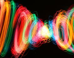 Cord of colored Christmas lights being twirled like a jump rope.