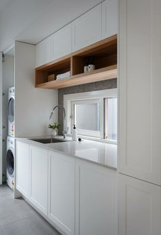 Luxe laundry featuring white Shaker cabinetry and open timber shelving from Freedom Kitchens. By winners Josh & Elyse. Laundry Nook, Laundry Room Storage, Laundry In Bathroom, Laundry Cupboard, Laundry Cabinets, Modern Laundry Rooms, Laundry Room Inspiration, Laundry Room Design, Küchen Design