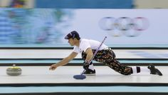 Norway skip Thomas Ulsrud, wearing rose-painting knickers and a patterned flat cap, delivers the stone during curling training at the 2014 Winter Olympics in Sochi.