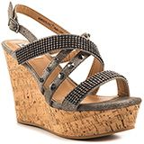 Sparkle brighter than the sun in the Viti by Not Rated.  Faux pewter leather creates the winding straps along with rhinestone mesh, edgy studs and stones.  An adjustable heel strap, 4 1/2 inch cork wedge and 1 1/2 inch platform perfect this summer look.