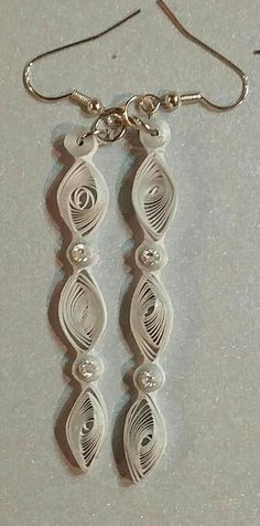 These triple tiered earrings are made with while paper with a silver edge. They are accented with small CZ stones. E5 Mom