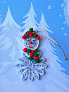 Love the use of a snowflake for his body ~ but decorate with quilled holly leaves & berries!