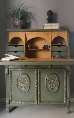 Artist​ Nick Vardakas of Artistic Paths is based in Greece and creates incredible work with Annie Sloan products. He used Chalk Paint®️️ by Annie Sloan in Olive and Arles with the stenciled designs done in Barcelona Orange. The moldings were highlighted with Annie Sloan Gilding Wax. The deepen the rich colors and create an aged look, Dark Chalk Paint®️️ Wax was used to finish the secretary. Beautiful!