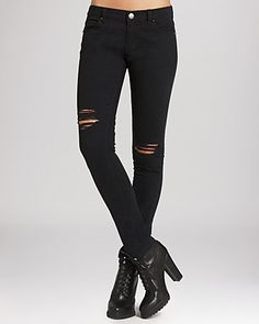 ::ripped black skinny jeans are a classic. these are effortlessly chic especially when paired with a black heeled bootie and deep v tank top::