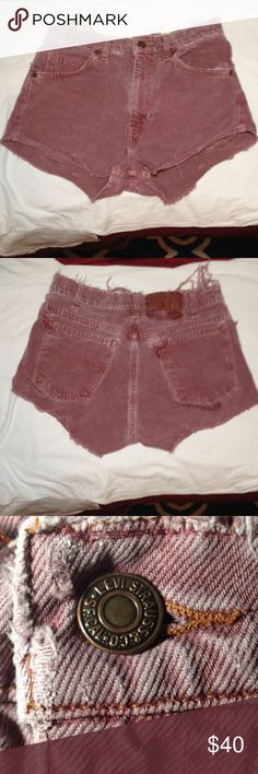 Red Levi high waisted shorts from Urban Outfitters SEXY red❤️ Levi brand. High Waisted shorts from URBAN OUTFITTERS. Very short and cheeky. The holes and frays were all there when purchased. Barely been worn. I will send studs for extra flare upon request. Levi's Shorts Jean Shorts