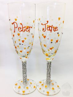 A pair of wedding champagne glasses with plenty of bling! x