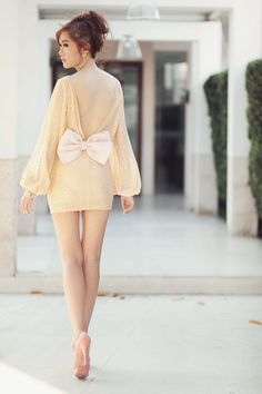 this dress with the plunging back with a bow is adorable!