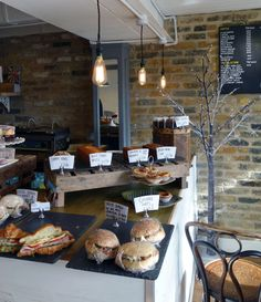 Food display on slate. Winner of London's Best Coffee Shop 2014. White Mulberries Cafe London