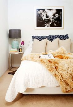 I love the girly bed and nightstand mixed with the rock and roll photo