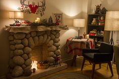 This DIY paper maché fireplace built from cardboard scraps, newspaper, kraft paper, and, of course, flour & water adds woodsy cabin holiday charm and offers stellar place to hang Christmas stockings.