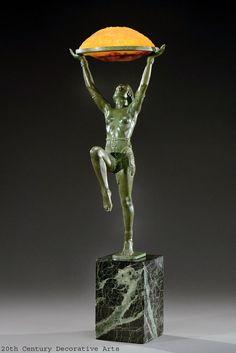 "An Art Deco patinated metal figural lamp ""Danseuse a la Coupe"" by Max Le Verrier, with glass shades by Daum, Paris circa 1930."