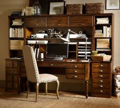 A vintage printer's cabinet with dozens of small drawers for storing type from Pottery Barn.