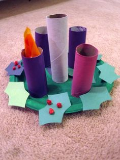 Advent wreath... Use handprints traced and cut out on green paper for the leaves instead of 'holly & berries'