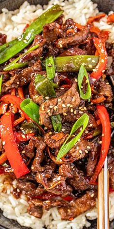 This copycat recipe for PF Chang's Mongolian Beef is so easy to make! Crispy yet tender beef slices with veggies in a sweet and savory homemade Mongolian beef sauce.