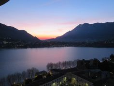 An excellent way to see Lecco and Lake Como is from above atop the bell and clock tower Campanile di San Nicolò. This is Lecco's top tourist attraction but is Lake Como Italy, Tower, Sunset, Travel, Outdoor, Outdoors, Rook, Viajes, Computer Case