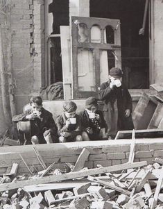 Children drink up in the ruins of London. The Blitz, WWII.   Unattributed  (rw)
