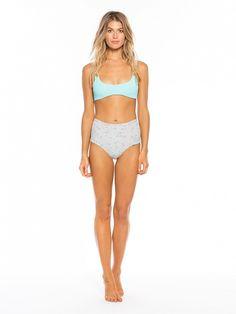 Tori Praver's swimsuit collaboration with Target: Bralette Bikini Top in aqua blue and High-Waist Bikini Bottoms in silver floral