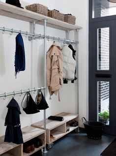 Small Space DIY: A Perfect Shoe Rack for a Narrow Entryway - Gardenista Narrow Entryway, Entryway Storage, Hallway Shelving, Entryway Closet, Garage Entry, Shoe Storage, Organized Entryway, Pipe Shelving, Storage Area
