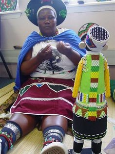 Siyazama Zulu doll maker from the Msinga area of KwaZulu Natal. YOu can find some of their small dolls thought www.africanthreads.ca