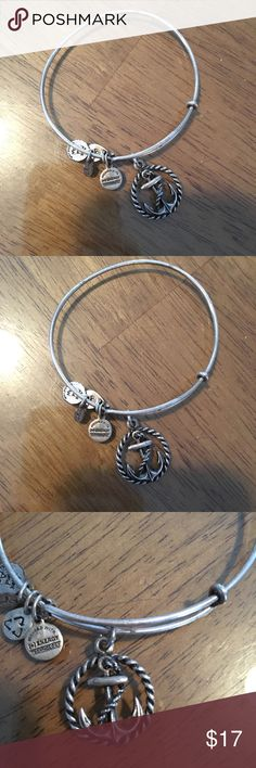 Alex & Ani Anchor Charm Silver Bracelet Hope, Tranquility, Prosperity. This wonderful anchor charm bracelet from Alex & Ani. Adjustable silver lightweight bangle. Worn but in good shape, some wear can be seen in pictures. Happy shopping! Alex & Ani Jewelry Bracelets