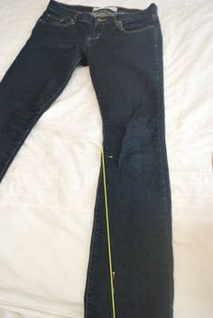 *yah, I mastered this in like - 1986.  :)  ...... Boot cut jeans into skinny jeans:with your pants turned inside out, sew from the knee pin to the ankle pin at a nice even angle. Start sewing just barely off of the pants and gradually angle onto the pants. This will make a nice taper with no weird tucks or gathers at the knee.