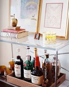 """bar tray via lonny mag; loving the """"So  married adventure"""" sitting atop and the tray of liquor"""