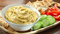 Hummus (With Mix-ins + Toppings) 1 cups dried chickpeas 1 teaspoon baking soda 6 cups water 1 cup plus 2 tablespoons light tahini paste 4 tablespoons freshly squeezed lemon juice 4 cloves garlic, crushed Salt 6 tablespoons ice-cold water Slimming Eats, Slimming World Recipes, Seitan, Pain Pita, Roasted Garlic Hummus, Pear Recipes, Healthy Recipes, Dip Recipes, Healthy Snacks
