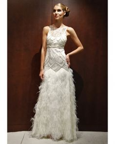 Sue Wong    This Art Deco-inspired beaded gown features a laser-cut petal skirt trimmed with ostrich feathers. W2111
