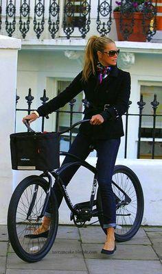 Elle McPherson bike riding.