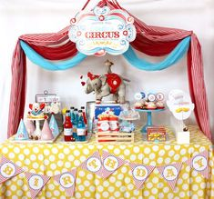 Circus Birthday party with easy DIY on how to drape circus tent top design over a dessert table