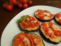melanzane gratinate con mozzarella e pomodori