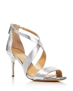 96501945d Imagine Vince Camuto s metallic heeled sandals add stunning shine to  night-out looks.