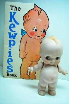 Vintage Glass Kewpie Doll and Book.